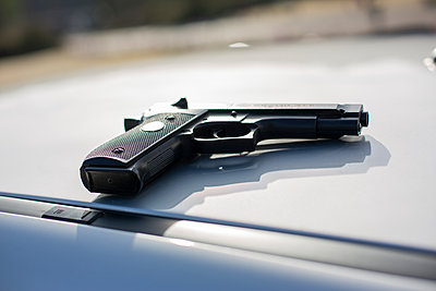 Gun on a car - p975m2247741 by Hayden Verry
