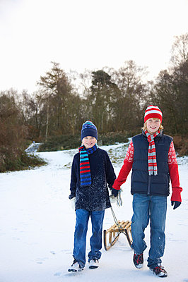 Boys with sled - p6690258 by Jutta Klee photography