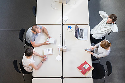 Four people in startup meeting - p1284m1452120 by Ritzmann