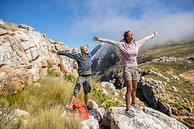 Young couple mountain hiking - p1355m1574170 by Tomasrodriguez