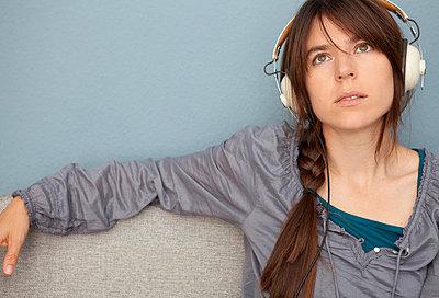 Woman with headphones - p4540872 by Lubitz + Dorner