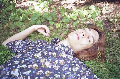 Man lying on the grass - p1229m2082601 by noa-mar