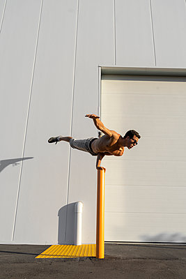 Acrobat training on a pole - p300m2012376 by VITTA GALLERY