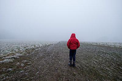 Boy in a red jacket - p1228m2230864 by Benjamin Harte