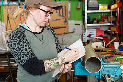 Woman working in workshop - p312m2262867 by Phia Bergdahl