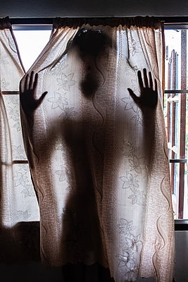 Female silhouette behind curtain - p1567m2173028 by Claire Picheyre