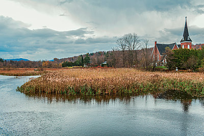 River and church in rural landscape - p555m1305771 by Eric Raptosh Photography