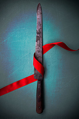 Knife Blade with Red Ribbon  - p1248m2108610 by miguel sobreira