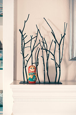 Russian Doll on Mantel with Tree Sculpture - p1617m2264074 by Barb McKinney