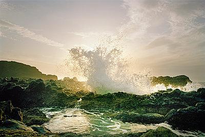 Wave splashing against rocks - p1207m1093914 by Michael Heissner