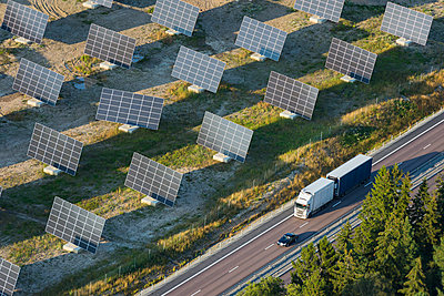 Solar farm near road - p312m1107621f by Hans Berggren