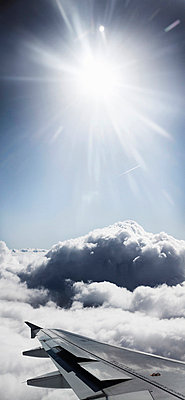Airplane wing flying over clouds - p42917439f by bergh dk