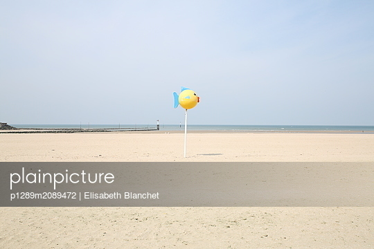 Fish figurine at the beach - p1289m2089472 by Elisabeth Blanchet