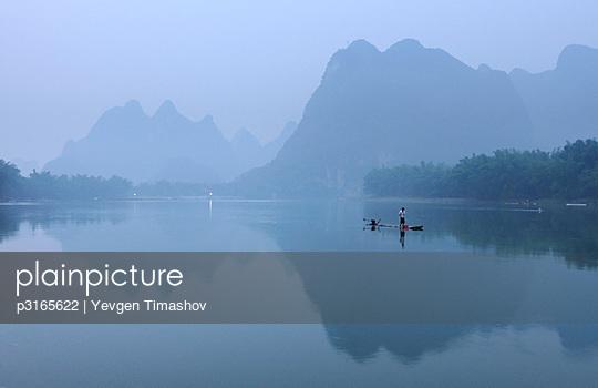 fisherman on Li Rivernear Yangshuo in Guilin region of China - p3165622 by Yevgen Timashov