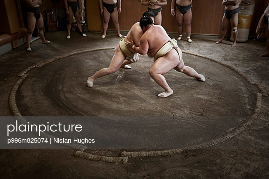 two sumo charging at each other during a practice session