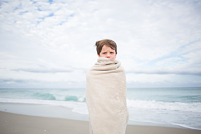 Boy at the beach - p1308m2065284 by felice douglas