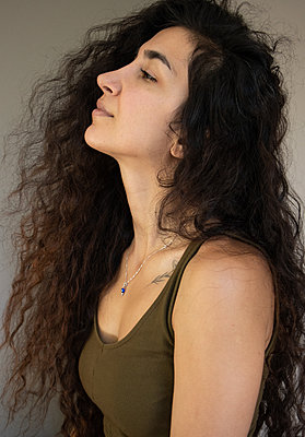 Young woman with long curly hair - p1640m2245808 by Holly & John