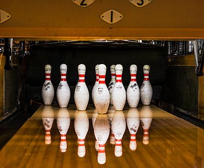 Bowling pins in row - p312m1113802f by Elliot Elliot