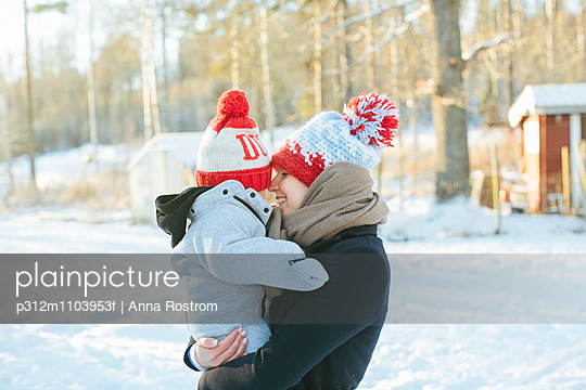 Mother carry baby - p312m1103953f by Anna Rostrom