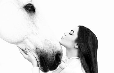 Woman and white horse - p548m911636 by Fred Leveugle