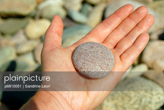 Pink Pebble on the palm of a hand - p6810051 by Sandrine Léon