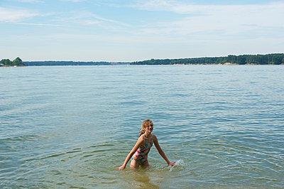 Girl swimming - p1169m1054882 by Tytia Habing