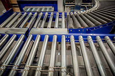Empty conveyer belt in distribution warehouse - p429m803051f by Arno Masse