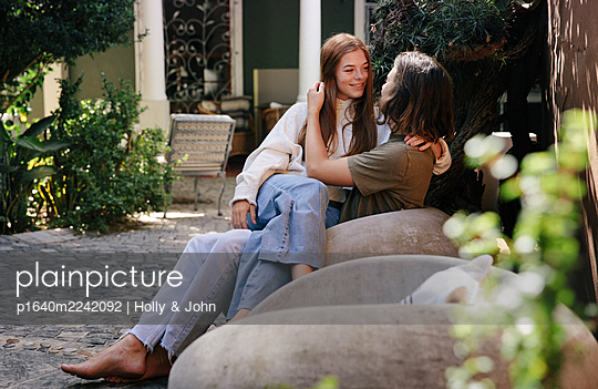 Teenage couple in love in the garden - p1640m2242092 by Holly & John