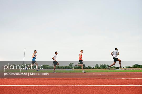 Runners training on running track - p429m2069335 by Matt Lincoln
