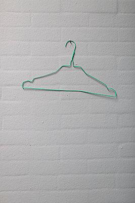 Clothes hanger - p642m813156 by brophoto