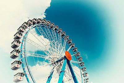Ferris wheel amusement park clouds sky Oktoberfest - p609m1534433 by OSKARQ