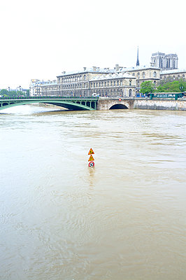Road sign submerged in the river Seine - p1096m1165426 by Rajkumar Singh