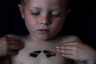 Child and Butterfly Wings - p1262m1110431 by Maryanne Gobble