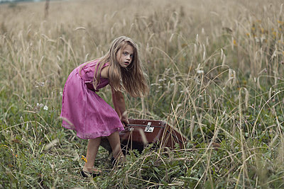 Girl dragging the bag - p1476m1558717 by Yulia Artemyeva