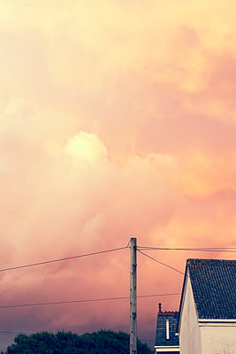 Sunset light and overcast sky - p879m2044707 by nico