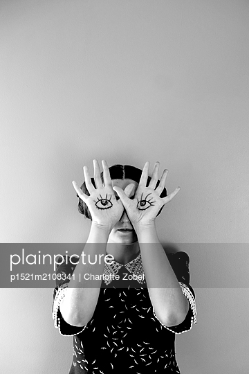 Eyes drawn on palms - p1521m2108341 by Charlotte Zobel