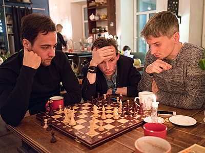 Playing chess in a cafe - p390m2053545 by Frank Herfort