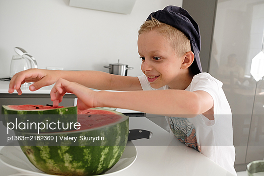 Boy eating watermelon - p1363m2182369 by Valery Skurydin