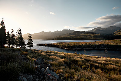 Mountain lake at sunset - p1092m2054268 by Rolf Driesen