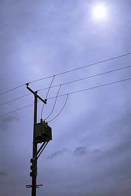 Telephone pole against a blue sky - p1228m1440034 by Benjamin Harte