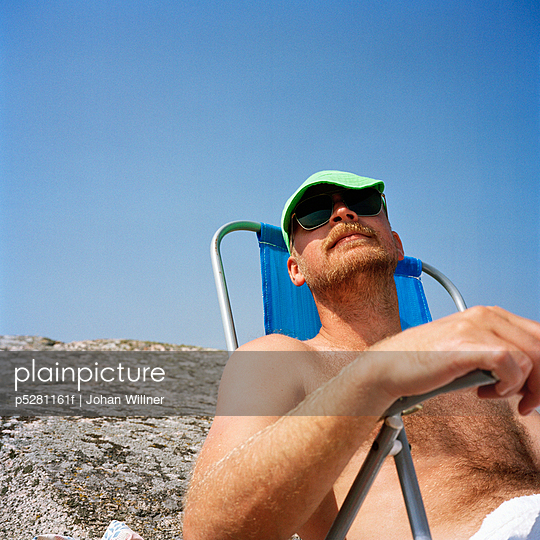 A man in a sun chair Sweden