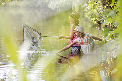 Two girls fishing together in a lake - p300m1450115 by Milton Brown