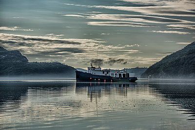 Fishing vessel in Geographic Harbor at sunrise, Southwest Alaska, USA - p442m1193243 by Marg Wood