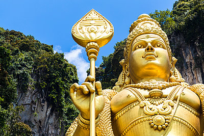 Low angle close up of colossal golden statue of Hindu deity. - p1100m1520367 by Mint Images