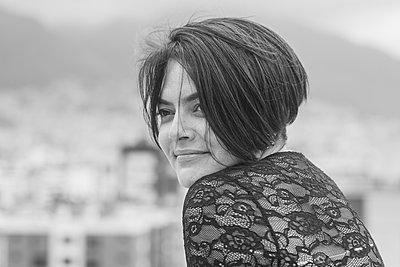 Smiling female flamenco dancer looking away - p300m2273960 by MORNINGVIEW AGENCY