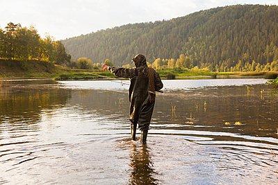 Mid adult man fishing in river, Sarsy village, Sverdlovsk Region, Russia - p429m1021621f by Aliyev Alexei Sergeevich