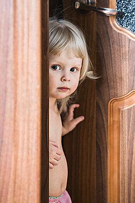 Girl standing by open door - p301m844059f by Vladimir Godnik