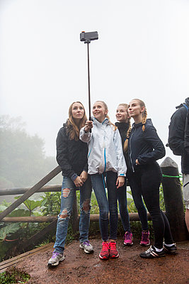Group of teenage girls taking selfie - p312m1131322f by Lena Granefelt