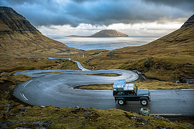 SUV climbing a twisting road, Faroe Islands. - p343m1520854 by Paolo Sartori