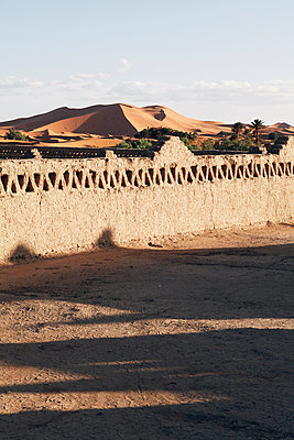 Looking out over the wall onto Moroccan desert - p1150m1586600 by Elise Ortiou Campion